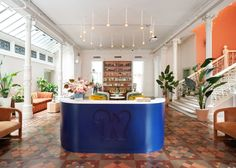 A building in New York's East Village has been given a new lease on life as headquarters for co-working club The Wing. Lactation Room, Decorative Pillars, Innovative Office, New York Soho, Brick Facade, Cool Office, Office Ideas, Co Working, East Village