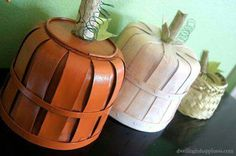 Little bushel baskets converted into pumpkins idea