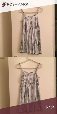 Forever 21 Medium Green/White Sun Dress Only worn once, this sun dress is perfect for summer! The picture looks like it's grey and white but it's more of an olive green and white tye-dye. The straps are adjustable and it has a cute cut out in the back. Forever 21 Dresses Mini