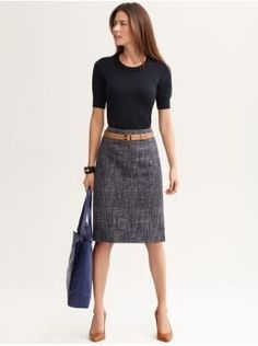I'd recommend a jacket, but really like this (from LiveCareer): Textured Indigo Pencil Skirt. Beaded Puff-Sleeve Pullover.