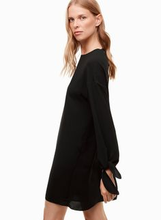 This shift dress is made with a lightweight crepe fabric from Japan that drapes perfectly. Adjustable ties at the back neckline and cuffs add a feminine touch. Crepe Fabric, Fashion 2017, Neckline, Feminine, Winter 2017, Black, Fall, Tops, Dresses