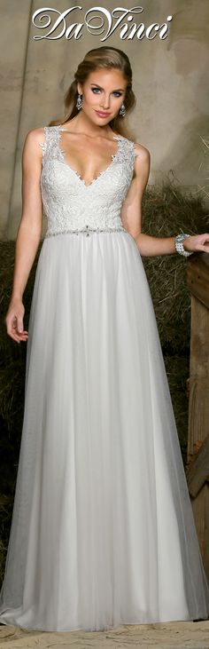 DaVinci Bridal Style # 50322 Lace bodice features a v neckline with lace straps that extend to create an open back. Natural waistline is accented with beaded trim and extends to a tulle slim  A-line skirt.  Chapel length train.  http://www.davincibridal.com/