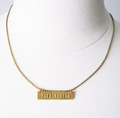 I love the idea of cutting out your name from a credit card and using it in another way.  This necklace isn't my thing, but I can see using it in a scrapbook project.