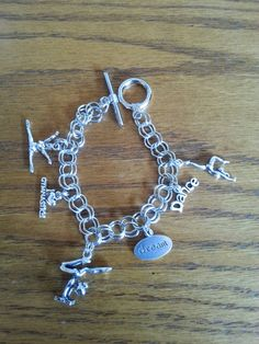 Check out this item in my Etsy shop https://www.etsy.com/listing/223244544/gymnast-charm-bracelet
