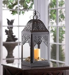 Buy Large Steeple Candle Lantern at wholesale prices. We offer a large selection of cheap Wholesale Candle Lanterns. If you need Large Steeple Candle Lantern in bulk at a discount price then buy from WholesaleMart. Lanterns Decor, Candle Lanterns, Glass Candle, Candle Sconces, Clear Glass, Lantern Candle Holders, Black Candles, Wedding Table Centerpieces, Lanterns