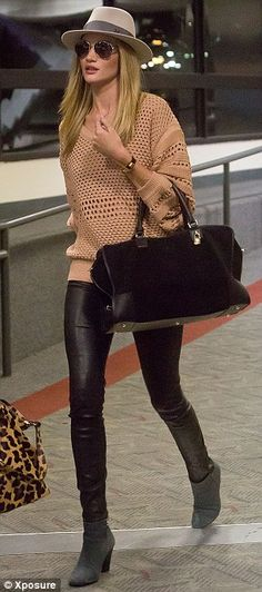 Catwalk power: The model's long legs drew a lot of attention as she made her way through the airport