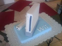 Wii Cake A Wii cake for my Sister's Friend's nephew. I made the wii out of rice cereal treats and the wii remote out of pure. Birthday Cookies, 7th Birthday, Cupcake Cookies, Birthday Ideas, Birthday Cake, Cupcakes, Wii Party, Party Themes, Party Ideas