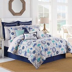 Close your eyes and feel the sea breeze as you relax with the Barnegat Coastal Comforter Set from Williamsburg. The comforter features subtle grey diamonds with all-over anchors, sea life, seashells and more in hues of blue and aqua. Solid blue bed skirt.