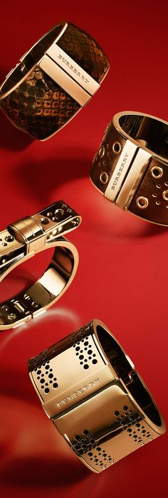 Metallic cuff bracelets with bow and eyelet detail from the Burberry A/W13 accessories collection