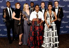(L-R) Actors Mahershala Ali, Kimberly Quinn, Kirsten Dunst, Aldis Hodge, Octavia Spencer, Glen Powell, Janelle Monae and Jim Parsons pose with the Ensemble Performance Award during the 28th Annual Palm Springs International Film Festival Film Awards Gala at the Palm Springs Convention Center on January 2, 2017 in Palm Springs, California. - 28th Annual Palm Springs International Film Festival - Backstage