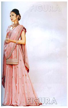 Bridal sharara in light pink color--Pakistani fashion. This looks like a lehenga, but is more of a split skirt.