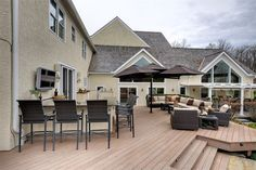 Deck with outdoor kitchen & bar of luxury home