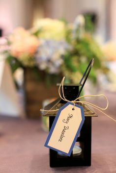 Mini lanterns double as wedding favors and escort cards Favors