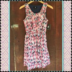 NWT Iz Byer dress New with tags. Lined Polyester dress. Machine wash cold. Size small. Belt loops attached at sides. But no belt available. Multicolored pink and blue and dark purple/blue. Dark blue lining. Iz Byer Dresses