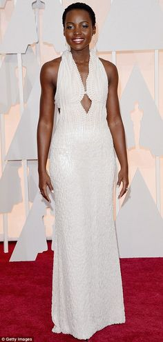 A stunning sight: Lupita Nyong'odazzled in a pearl encrusted Calvin Klein Collection frock with low-cut neckline