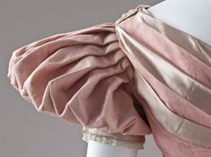 Detail of Dress, England, c. 1830. Silk plain weave (organza) and silk satin with imitation-pearl glass beads.