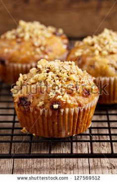 Banana muffins with walnuts and white chocolate on a cooling rack by Elena Veselova, via ShutterStock
