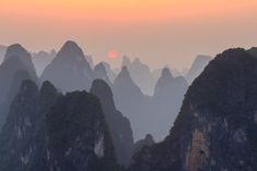 """""""Sunset at Li River"""". Enjoy sunset on top of Lao Zhai mountain at the bank of Li River. Location: Xingping, Guangxi, China. (Photo and caption by James Bian/National Geographic Traveler Photo Contest)"""