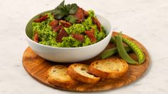 Smashed Peas With Bacon and Basil - Serve with baked ham, roast chicken or steamed fish. Or spoon onto crostini for an appetizer