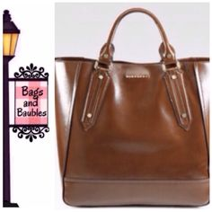 """New with Tag! BURBERRY Large Tote, Brown New with Tag BURBERRY Somerford Tote in Brown. Roomy carryall in textured patent leather, perfect for all your daily essentials! Double top handles, 5 1/4"""" drop, magnetic top closure, protective metal feet, one inside zip pocket and two open pockets, fully lined. Measures 15""""W x 14""""H x 6"""" D. [#0885]    Always Authentic 