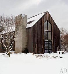 Beautiful use of barn siding -- D'Apostrophe Design renovated a weekend house in Remsenburg, New York. Much of its exterior was replaced with siding salvaged from a 200-year-old Canadian barn.