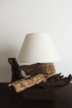 Driftwood lamp - This #lamp is made in Italy with #driftwood from Tyrrhenian Sea (Italy) and with a antique iron base.
