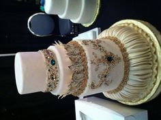 Whimsical wedding cake featured at the bridal expo