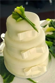 Wedding Cake: Simple, Beautiful with pink bow and pearls maybe?
