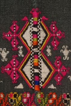Chemise of newly-married women from Fylakto in Evros( detail) of the decoration at the border: embroidered joint at the vertical seam and lozenge-shaped motifs (gonata, daoulia) embroidered with fouskoperassia