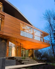 This luscious wood-paneled home plays the Cullen family mansion in the first film of the vampire saga, Twilight. With unusual angles, an extensive set of decks and patios, and a second story that literally juts out into thin air, the tree house-like home is a modern, wooded retreat. Designed by Skylab Architects, the space is a real residence in Portland, Oregon, though special effects were used to create the heavily wooded look of the surrounding area.   - ELLEDecor.com