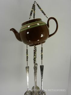 Wind chime ceramic tea pot with stone by WhisperingMetalworks, $85.00
