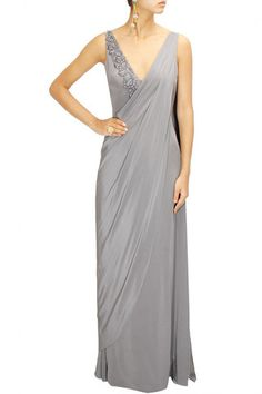 Dress in this perfect saree gown this wedding season for a trendy and sleek look.