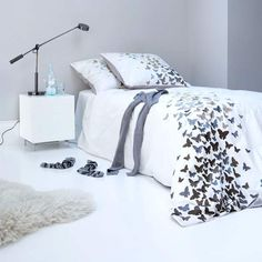 Luxe modern bedroom. Give your bed show-stopping style with an eye-catching bed linen. The butterflies cascade off the corner of the bed creating a wonderful focal point, and the rest of the room is kept simple to allow the pattern to sing out. #Sleeptember