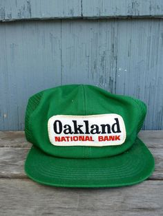 Oakland National Bank green trucker hat with snapback and