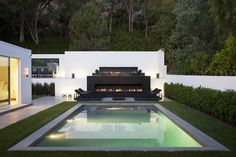 I LOVE pools. Especially serene, beautiful backyard pools surrounded by lush grass. So chic.