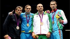 (L-R) Silver medallist Clemente Russo of Italy, gold medallist Oleksandr Gvozdyk of Ukraine, bronze medallist Tervel Pulev of Bulgaria and bronze medallist Teymur Mammadov of Azerbaijan celebrate on the podium during the medal ceremony for the Men's Heavy (91kg) Boxing final bout on Day 15 of the London 2012 Olympic Games at ExCeL