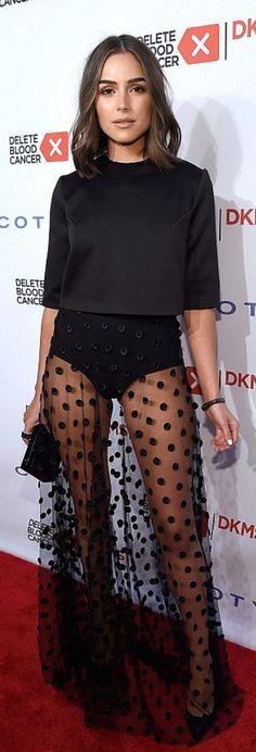 Who made Olivia Culpo's black polka dot maxi skirt, clutch handbag, and top?