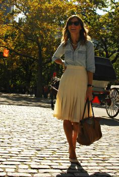 Love the light denim shirt with the pleated skirt.