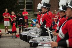 The Big Red Marching Machine performs at the Homecoming 2013 parade.