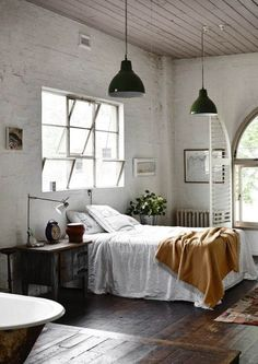 ...not a huge fan of the industrial lighting, but I love the cracked open windows and oatmeal color on the walls.