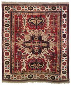 CHELABERD KAZAK RUG SOUTH CAUCASUS, EARLY 19TH CENTURY 5ft.9in. x 4ft.9in. (175cm. x 145cm.)