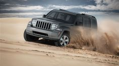 Trail Rated® Jeep® Liberty Sport 4x4 shown in Mineral Gray Metallic with available Skid Plate Group. Facebook: https://www.facebook.com/JeepCanada Twitter: https://twitter.com/jeepcanada