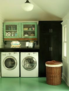 A blend of modern appliances and vintage furnishings, such as these distressed wooden cabinets, lend this laundry room an authentic aesthetic. Vinyl floor is more hygienic due to no grout. Laundry Room Organization, Laundry Room Design, Laundry In Bathroom, Laundry Rooms, Small Laundry, Basement Laundry, Laundry Area, Organizing, Laundry Basket