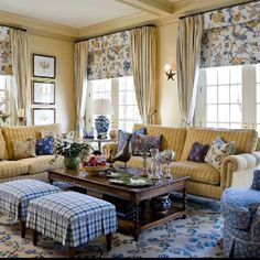 Blue & yellow living room - like the mix of prints/patterns...