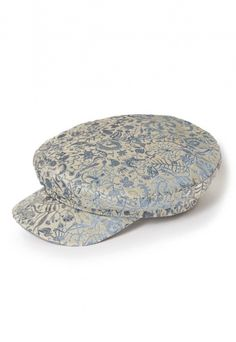 The Lennon Cap sees the re-invention of Lock & Co.'s original design using Westwood's luxury Gold Label stock fabrics, the hat was inspired by Vivienne's Do It Yourself concept of recycling clothes and materials.