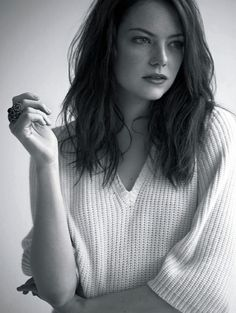 Emma Stone.  I like her so much more as a redhead/brunette than I blonde.