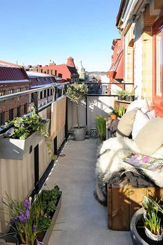 Cute balcony in Sweden. Need some of these wind break panels for our deck. Source: Alvhem via Freshome
