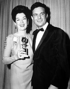 Golden Globe winner Rosalind Russell poses with presenter Cliff Robertson. March, 1963