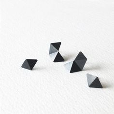 This set of four stud earrings allows you to mix & match pair of earrings by yourself. The earrings set includes four stud earrings (2 different pairs).  The geometric silver stud earrings is handcrafted, inspired by Hexagon shape. They are fold into three dimensional shapes. The earrings are made of sterling silver and have two finishes; - brushed silver - oxidized silver  Ear pins are made of sterling silver. They come with sterling silver backs. The minimalist earrings reflect well wit...