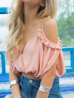 Pink #croptop with #ruffles mixed with blue #denim. More summer inspirations on…